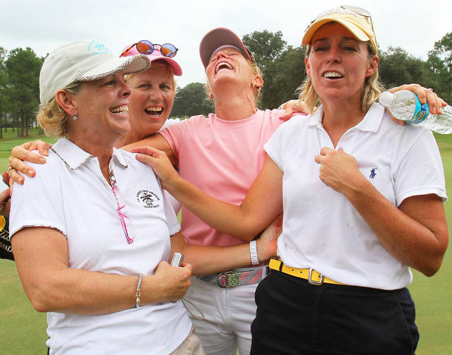 Martha Leach of Hebron Ky., right, celebrates with her friends, Nancy Grote, Sallie Sumerel and Mary Jane Hiestand, left to right, on the 16th hole  after winning the   Women's Mid-Amateur Championship golf tournament at the Golden Hills Golf & Turf Club in Ocala, Fla., Thursday, Oct. 8, 2009. AP PHOTO