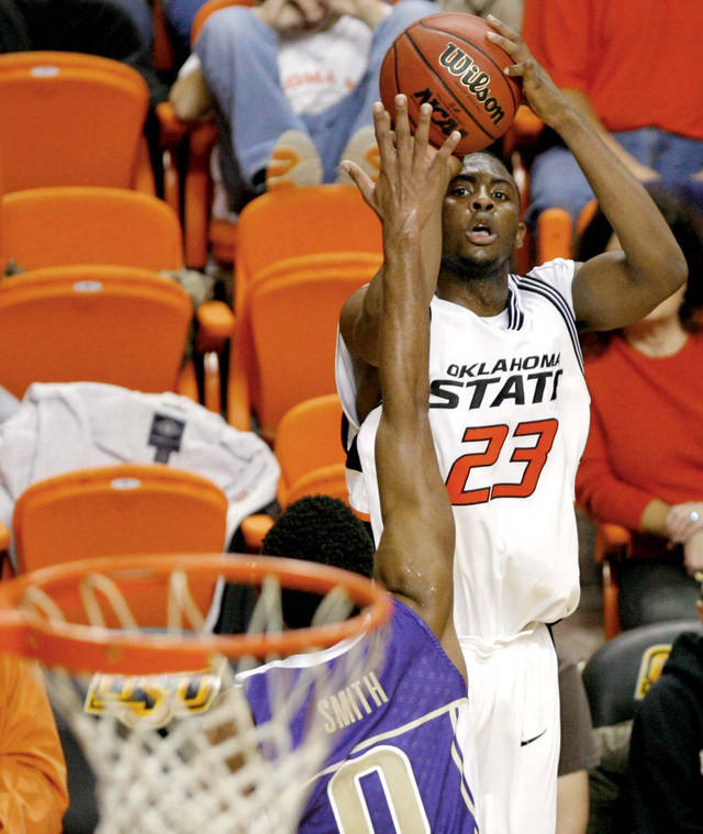 OSU's James Anderson (23) shoots over Washington's Joel Smith (0) in the second half during the college basketball game between Oklahoma State University and the University of Washington at Gallagher-Iba Arena in Stillwater, Okla., Saturday, December 1, 2007. By Matt Strasen, The Oklahoman
