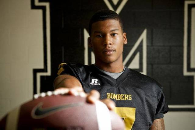 Midwest City's Ronnie Davis poses for a portrait in the Midwest City High School locker room on Tuesday, June 21, 2011. PHOTO BY ZACH GRAY, THE OKLAHOMAN <strong>ZACH GRAY - ZACH GRAY</strong>