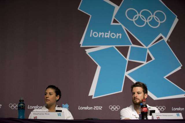 Australian swimmers James Magnussen, right, and Stephanie Rice listen to a journalist's question during a news conference at the Main Press Center ahead of the 2012 Summer Olympics, Monday, July 23, 2012, in London. (AP Photo/Matt Dunham)