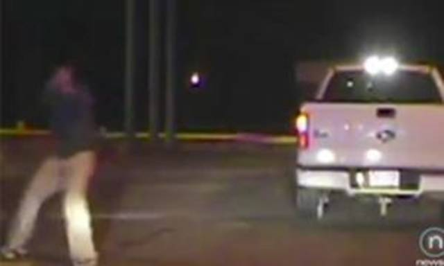 In this still taken from a police video, Brian Dollarhide pretends to fire gunshots at Perry police officers moments before they fatally shot him Tuesday.