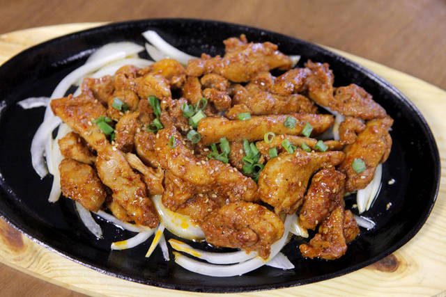 Chicken Bulgogi from Jeon Ju in Midwest City is served on a sizzling platter with a side of steamed rice. <strong>David McDaniel - The Oklahoman</strong>