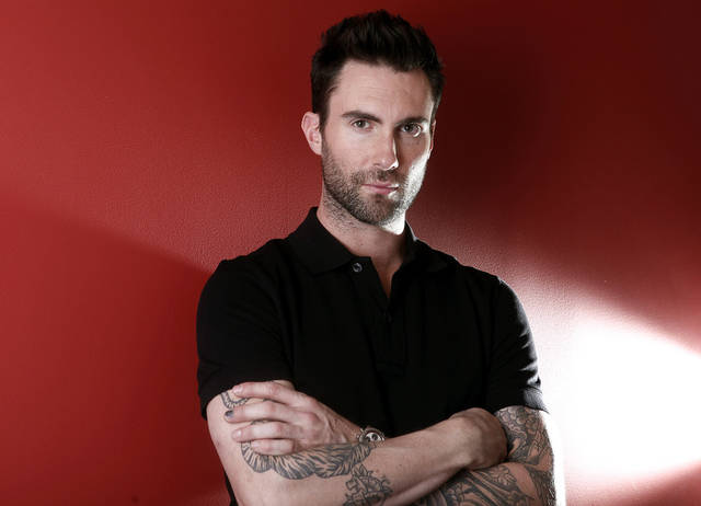   FILE - This Feb. 20, 2012 file photo shows Maroon 5 frontman Adam Levine in New York. The musician and star of TV&#039;s &quot;The Voice&quot; is up for favorite band, song, album and music video, along with favorite celebrity judge and favorite competition TV show for the People&#039;s Choice Awards. Nominations were announced Thursday, Nov. 15, at the Paley Center for Media in Beverly Hills, Calif. Fans chose the nominees by voting online and can do the same to select the winners. Voting in 48 categories continues through Dec. 13. The People&#039;s Choice Awards will be presented Jan. 9, 2013, and broadcast on CBS. (AP Photo/Carlo Allegri, file)  