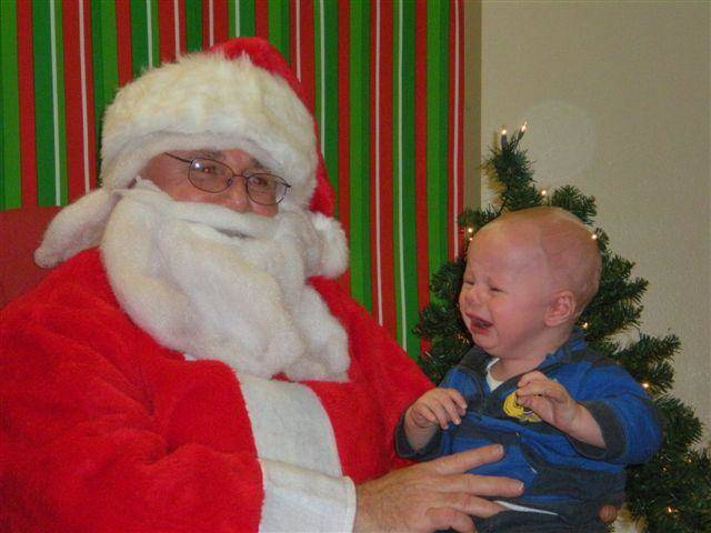 Noah Dutton, 8 months old, not impressed with Santa during Edmond church Christmas party