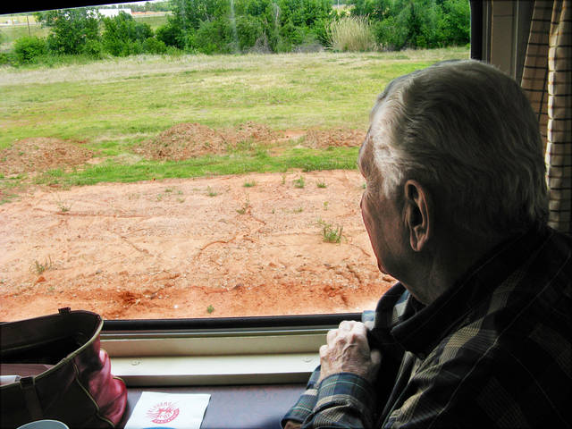 Lee Allan Smith glances out of window of Centennial train at future Adventureland train stop.  PHOTO BY STEVE LACKMEYER/THE OKLAHOMAN