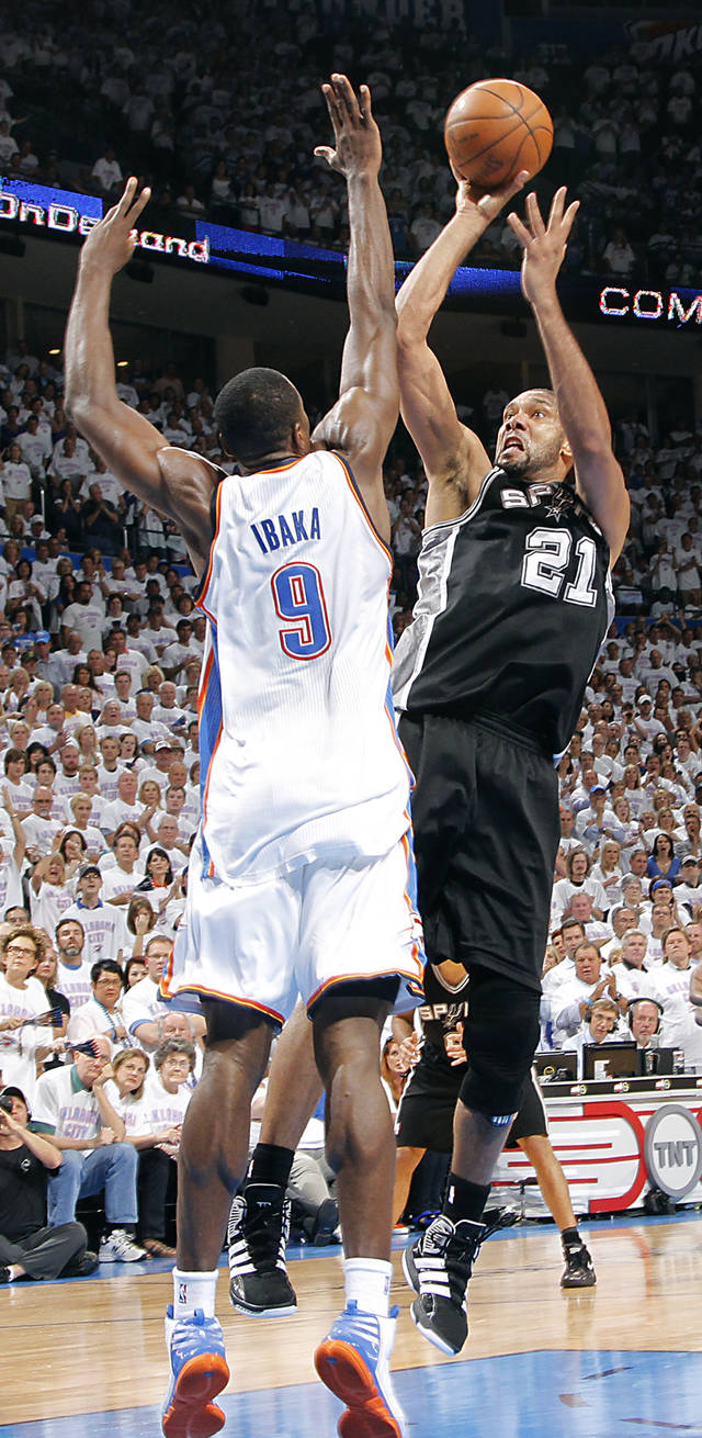 San Antonio's Tim Duncan (21) shoots the ball over Oklahoma City's Serge Ibaka (9) during Game 6 of the Western Conference Finals between the Oklahoma City Thunder and the San Antonio Spurs in the NBA playoffs at the Chesapeake Energy Arena in Oklahoma City, Wednesday, June 6, 2012. Photo by Chris Landsberger, The Oklahoman