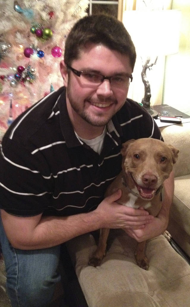 Scott Hill and his Pit Bull mix Maddie. Photo by Heather Warlick, The Oklahoman <strong></strong>