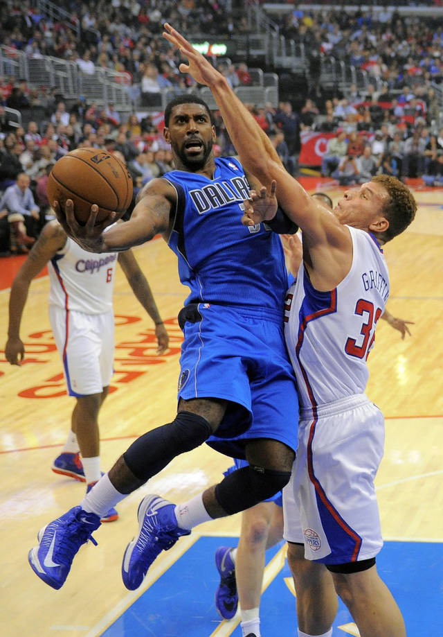 Dallas Mavericks guard O.J. Mayo, left, shoots as Los Angeles Clippers forward Blake Griffin defends during the first half of their NBA basketball game, Wednesday, Dec. 5, 2012, in Los Angeles. (AP Photo/Mark J. Terrill)