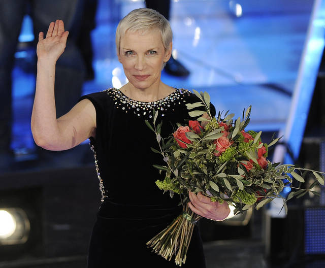 "FILE - This Feb. 21, 2009 file photo shows British musician Annie Lennox during the ""Festival di Sanremo"" Italian song contes in San Remo, Italy. Lennox has married for a third time. The singer�s publicist confirms Lennox married Mitch Besser in a private ceremony Saturday, Sept. 15, 2012, in London. Lennox, best known as The Eurythmics singer, and Besser, an American doctor and founder of the charity mothers2mothers, are both 57. (AP Photo/Antonio Calanni, file)"