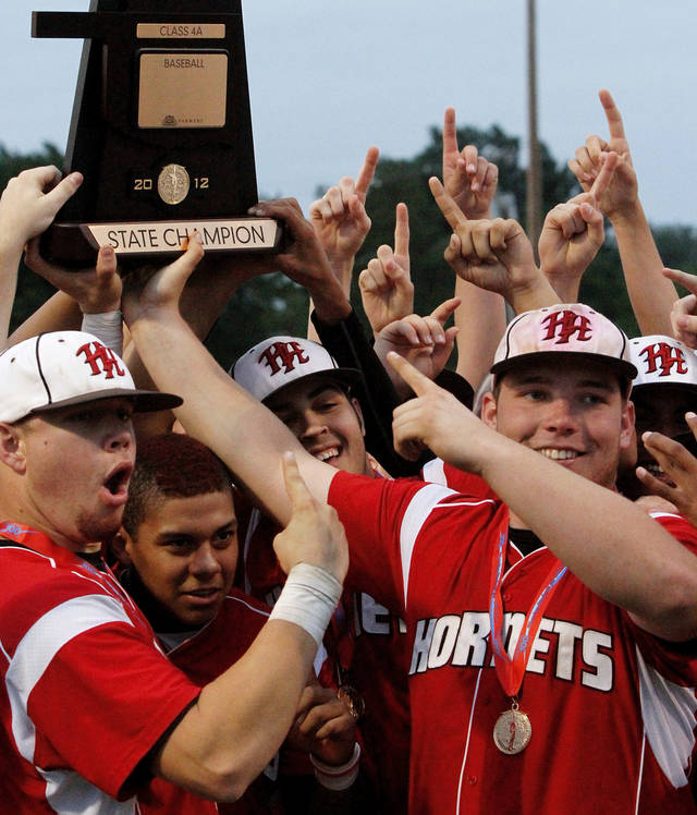 Hilldale players celebrate by hoisting the championship trophy after winning the Class 4A state high school baseball championship game  at Shawnee High School's Memorial Park. on Saturday,,  May 12, 2012.  The Hilldale Hornets defeated the Berryhill Chiefs, 2-1.      Photo by Jim Beckel, The Oklahoman