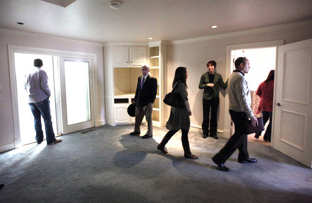 People tour a home on the future site of the Edmond 66 Park, Thursday, Jan. 19, 2012, in Edmond, Okla. Photo by Sarah Phipps, The Oklahoman