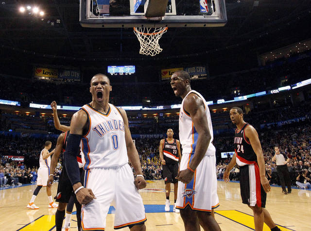 Oklahoma City's Russell Westbrook (0) and Serge Ibaka (9) celebrate a basket in front of Portland's Marcus Camby (23) and Andre Miller (24) during the NBA game between the Oklahoma City Thunder and the Portland Trailblazers, Sunday, March 27, 2011, at the Oklahoma City Arena. Photo by Sarah Phipps, The Oklahoman