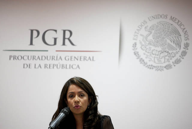 Mariana Benitez, Mexico's Assistant Attorney General speaks during a news conference in Mexico City, Thursday, April 4, 2013. Mexican prosecutors say they have broken up a plot by an armed gang to assassinate two federal legislators, a senator and a congressman, whom are also brothers from the north-central state of Zacatecas. According to Benitez, the armed gang was arrested Thursday at a hotel in downtown Mexico City. (AP Photo/Eduardo Verdugo)
