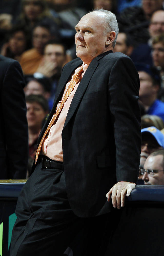 Denver Nuggets head coach George Karl watches the fourth quarter of an NBA basketball game against the Oklahoma City Thunder in Denver, Sunday, Jan. 20, 2013. The Nuggets won 121-118 in overtime. (AP Photo/David Zalubowski)