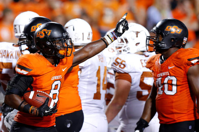 Oklahoma State's Daytawion Lowe (8) comes out with the ball after Texas' final touchdown during a college football game between Oklahoma State University (OSU) and the University of Texas (UT) at Boone Pickens Stadium in Stillwater, Okla., Saturday, Sept. 29, 2012. Oklahoma State lost 41-36. Photo by Bryan Terry, The Oklahoman