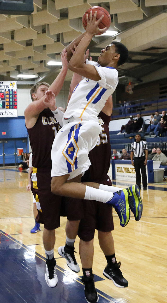 Piedmont's Adrion Williams (30) shoots over Clinton's Quinton Hand (10) during a basketball tournament at the Kingfisher High School gym on Thursday, Jan. 24, 2013, in Kingfisher, Okla.  Photo by Chris Landsberger, The Oklahoman