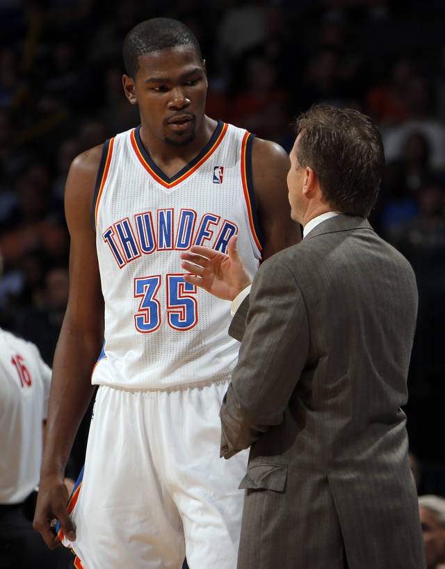 Oklahoma City head coach Scott Brooks talks with Kevin Durant during the preseason NBA game between the Oklahoma City Thunder and the Charlotte Bobcats at Chesapeake Energy Arena in Oklahoma City, Tuesday, Oct. 16, 2012. Photo by Sarah Phipps, The Oklahoman