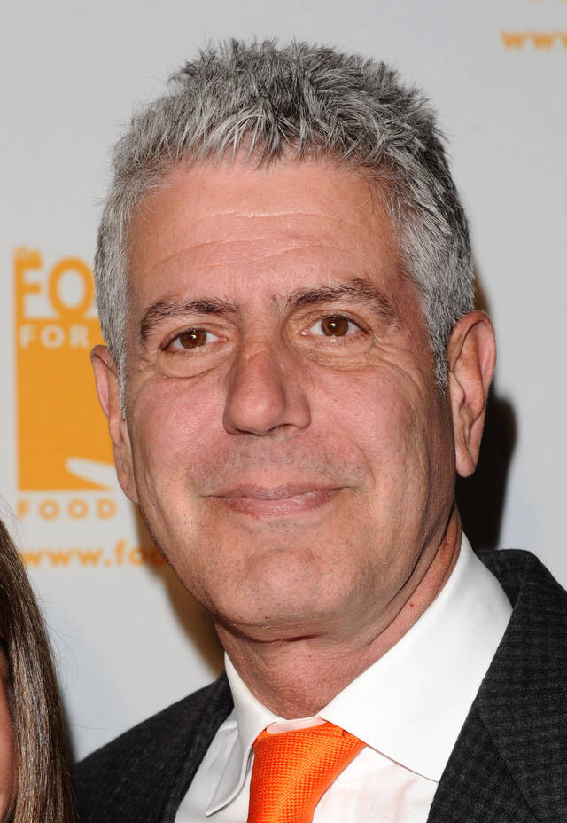 "FILE - In this April 7, 2011 file photo, Anthony Bourdain attends the Food Banks 'Can Do Awards' gala in New York. Bourdain's new Travel Channel series, ""The Layover,"" premieres Monday at 9 p.m. EST. (AP Photo/Peter Kramer, file)"