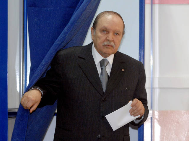 Algerian President Abdelaziz Bouteflika leaves a voting booth before voting in the Parliamentary elections in Algiers, Thursday, May, 10, 2012. Parliamentary elections in Algeria are being billed as the fairest in 20 years, but as polls opened Thursday disgruntled Algerians appeared to be showing little interest and even outright scorn for the vote. There are 44 political parties competing for 462 seats across this vast oil-rich North African nation of 35 million people, Africa's largest by area. (AP Photo/Sidali Djarboub)