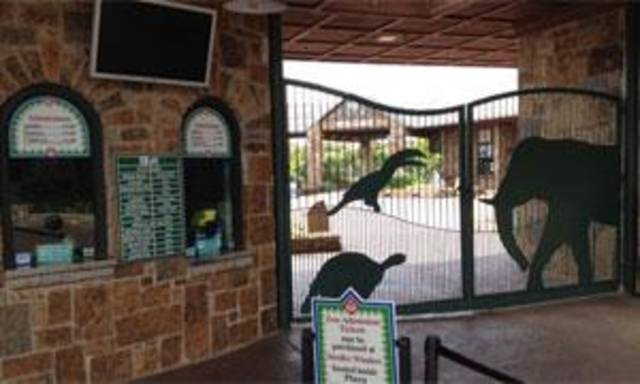 Gates at the entrance to the Oklahoma City Zoo are closed Thursday. Photo by Jim Beckel