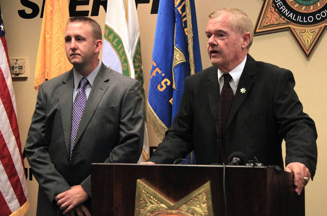 Bernalillo County Sheriff Dan Houston, right, and Lt. Sid Covington answer questions about the shooting deaths of five family members during a news conference at the sheriff's headquarters in Albuquerque, N.M., on Tuesday, Jan. 22, 2013. Authorities have charged Nehemiah Griego, 15, with murder and child abuse counts in connection with the slaying of his family. (AP Photo/Susan Montoya Bryan)