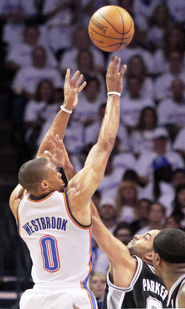 The Thunder's Russell Westbrook shoots the ball over San Antonio's Tony Parker during Game 6 of the Western Conference Finals.  Photo by Bryan Terry, The Oklahoman