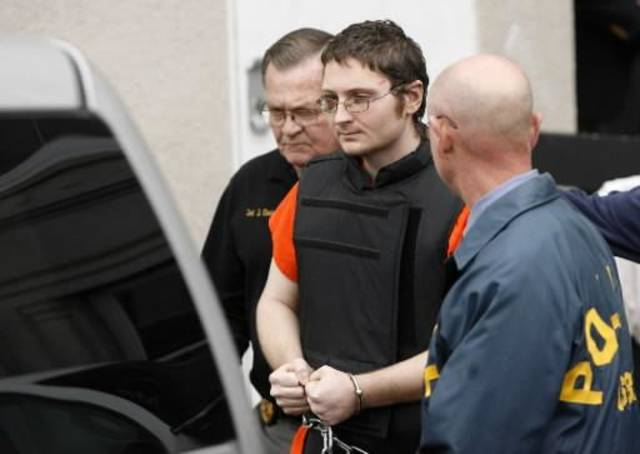 Kevin Sweat is escorted to a waiting vehicle after a hearing at the Okfuskee County Courthouse in Okemah, Okla. on Tuesday, December 13, 2011. Sweat is accused of killing Taylor Paschal-Placker and Skyla Whitaker on a dirt road near Weleetka. MATT BARNARD/Tulsa World