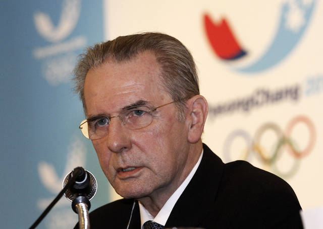 FILE - In this Friday, Feb. 1, 2013 file photo International Olympic Committee (IOC) President Jacques Rogge speaks during a press conference in Seoul, South Korea. IOC President Jacques Rogge said in an interview Wednesday May 22, 2013 with The Associated Press, Olympic officials have agreed that more targeted, out-of-competition testing is needed in the fight against doping. (AP Photo/Ahn Young-joon, File)