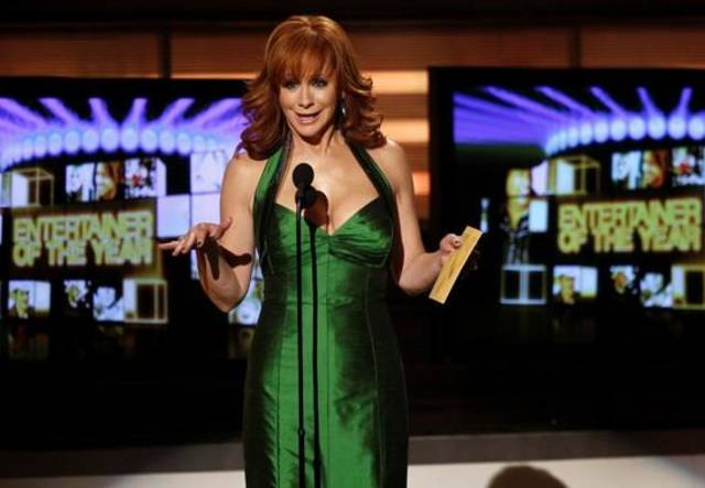 Reba McEntire presents the award for entertainer of the year at the 45th Annual Academy of Country Music Awards in Las Vegas on April 18, 2010. This year, McEntire will co-host the April 3 ACM Awards with fellow Oklahoma native Blake Shelton. (Associated Press file photo)