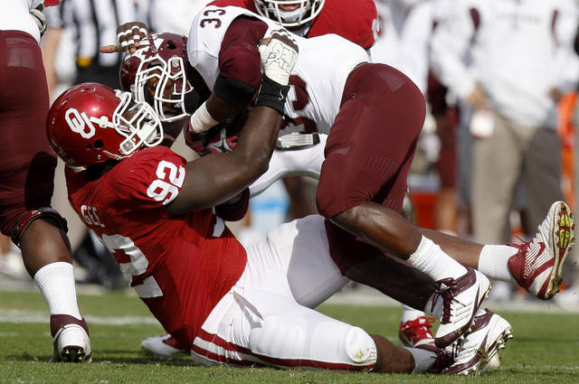Oklahoma's Stacy McGee (92) brings down Texas A&M's Christine Michael (33) during the college football game between the Texas A&M Aggies and the University of Oklahoma Sooners (OU) at Gaylord Family-Oklahoma Memorial Stadium on Saturday, Nov. 5, 2011, in Norman, Okla. Oklahoma won 41-25.  Photo by Bryan Terry, The Oklahoman