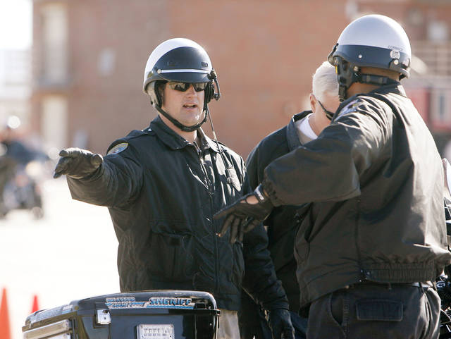 Edmond police officer Dan Butcher works with trainees during a motorcycle training school at the Edmond training facility in Edmond, OK, Friday, April 11, 2008. BY PAUL HELLSTERN, THE OKLAHOMAN