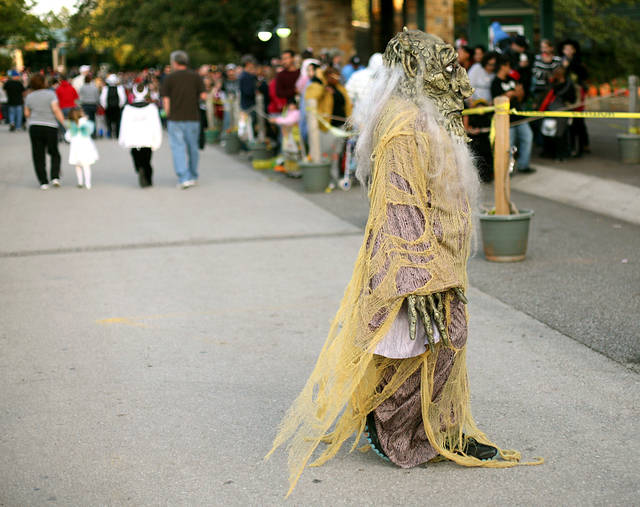 Above: A costumed visitor walks toward the ticket line at the Oklahoma City Zoo before the Haunt the Zoo for Halloween trick-or-treat event. More than 30,000 people attended the six-day event.