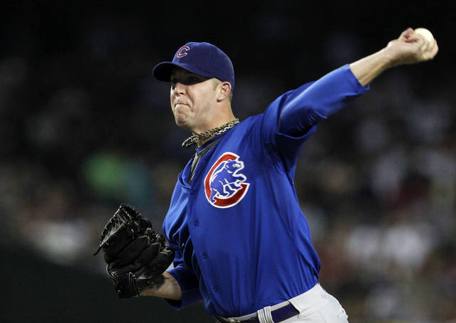 Chicago Cubs' Paul Maholm throws against the Arizona Diamondbacks during the first inning of a baseball game Saturday, June 23, 2012, in Phoenix. (AP Photo/Ross D. Franklin)
