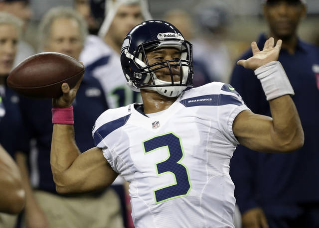 Seattle Seahawks quarterback Russell Wilson (3) warms up before an NFL football game against the Detroit Lions, Sunday, Oct. 28, 2012. in Detroit. (AP Photo/Paul Sancya )