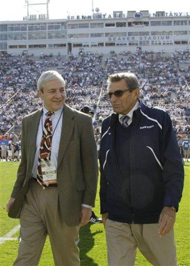 In this photo take Oct. 8, 2011 Penn St. President Graham Spanier, left, and head football coach Joe Paterno visit during warm ups before an NCAA college football game against Iowa in State College, Pa., Saturday, Oct. 8, 2011. (AP Photo/Gene Puskar, File)