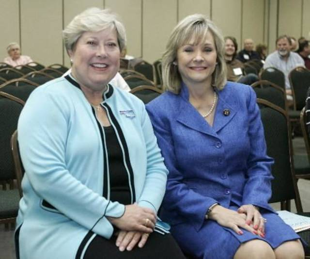 Oklahoma Lt. Gov. Jari  Askins, left, the Democratic candidate for Governor, and U.S. Rep. Mary  Fallin, R-Okla., the Republican candidate for Governor, are pictured as they wait to speak to a business forum in Oklahoma City, Wednesday, July 28, 2010. (AP Photo/Sue Ogrocki)