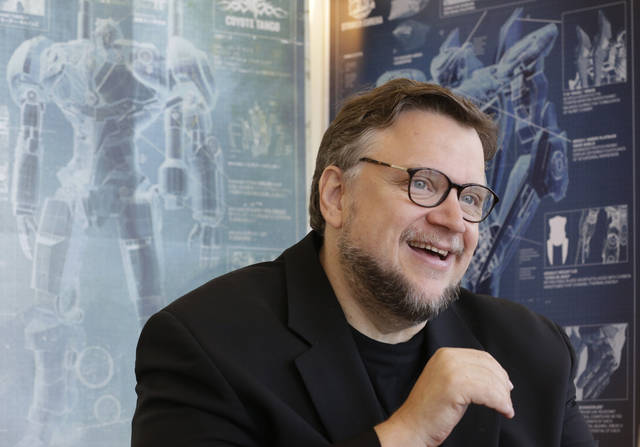"In this Wednesday, June 26, 2013 photo, Mexican director Guillermo del Toro speaks about his new film ""Pacific Rim"" during an interview in Miami. (AP Photo/Wilfredo Lee) ORG XMIT: FLWL201"