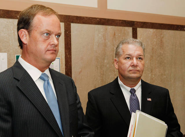 Oklahoma County District Attorney David Prater, right,  and Assistant District Attorney Scott Rowland wait for an elevator in a courthouse hallway after meeting with Judge Tammy Bass-Lesure in her chamber Tuesday morning,  Aug. 31, 2010.  They want the judge to recuse herself from presiding at murder trial of Oklahoma City pharmacist Jerome Ersland in September.  Photo by Jim Beckel, The Oklahoman