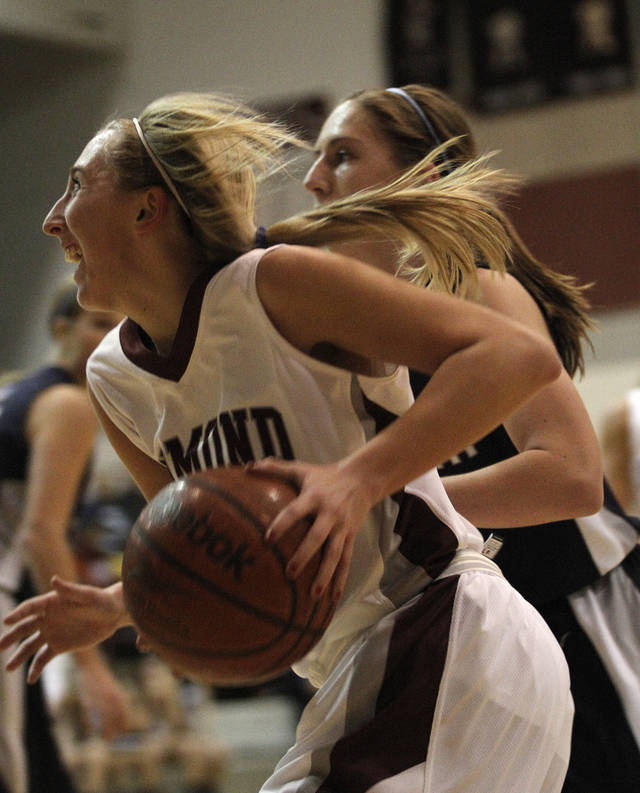 Edmond Memorial's Kelsey Glover (34) during a high school basketball game between Edmond Memorial and Edmond North at Edmond Memorial High School, Tuesday, Dec. 20, 2011.  Photo by Garett Fisbeck, The Oklahoman ORG XMIT: KOD