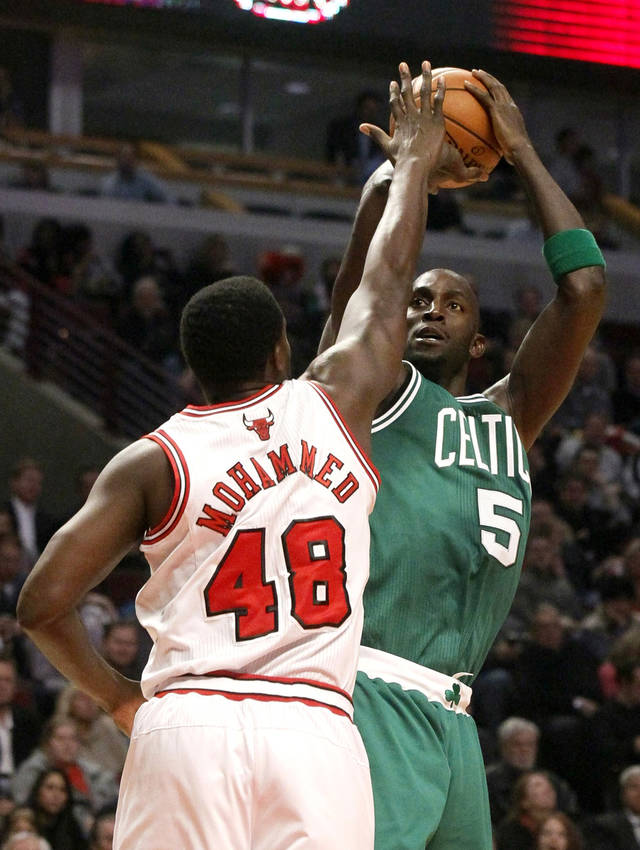 Boston Celtics forward Kevin Garnett (5) shoots over Chicago Bulls center Nazr Mohammed during the first half of an NBA basketball game, Monday, Nov. 12, 2012, in Chicago. (AP Photo/Charles Rex Arbogast)