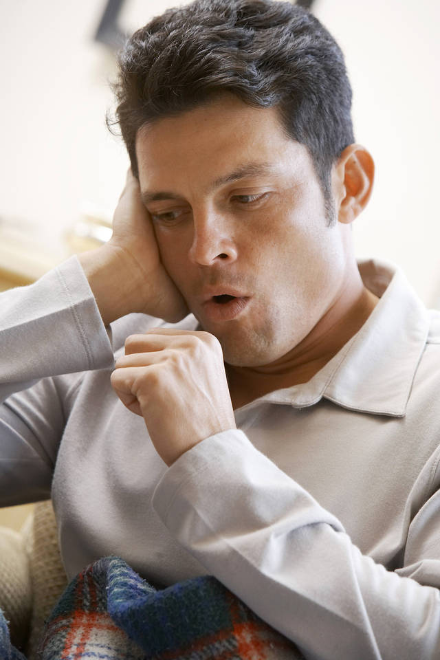 A cough is triggered when nerves in the larynx (voice box) or respiratory tract are stimulated. Getty Images
