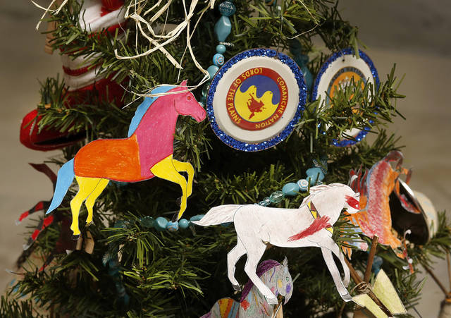 Colorful handmade ornaments adorn this tree decorated by students from Ft. Cobb-Broxton Middle School.  The tree's theme is 'Native Americans.'. School children from across the state came to the state Capitol  to decorate 36  small Christmas trees in the hallways and rotunda.  Gov. Mary Fallin and State Superintendent Janet Barresi joined Santa Claus in greeting the students at each tree after they were decorated. Many of the children stayed to watch the  governor light the state Christmas tree on the south plaza on Thursday,  Nov. 29, 2012.   Photo by Jim Beckel, The Oklahoman