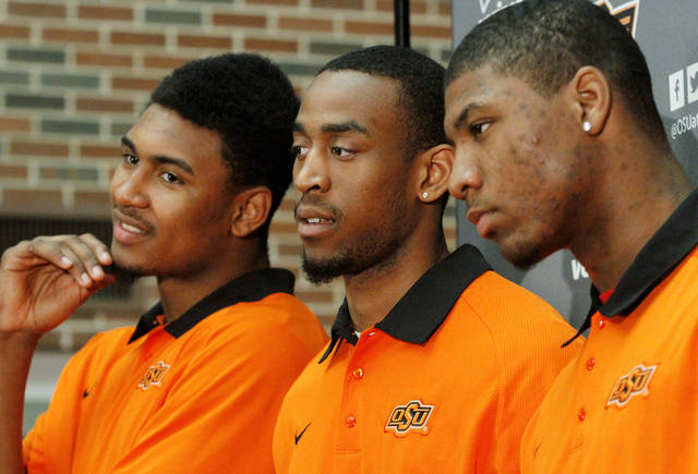 OSU basketball players, from left,  Le'Bryan Nash, Markel Brown and Marcus Smart delighted  fans when they announced at a noontime press conference they intend to return for another season as members of the Cowboys basketball team. Cheering fans lined all levels in the Student Union atrium Wednesday, April 17, 2013.    by Jim Beckel, The Oklahoman.