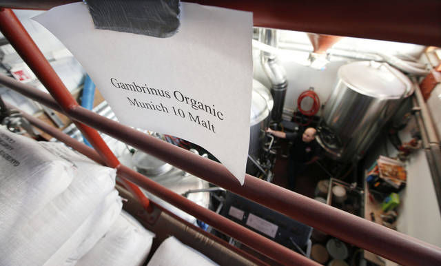 The storage area of the Elliott Bay Brewing Co. brewhouse is marked for organic products, Thursday, Sept. 29, 2011, in Seattle, where the company brews about a half-dozen organic, year-round beers and some seasonal beers. Northwest farmers have begun planting new varieties of hops, the key flavor-ingredient in beer, and working with researchers to develop ways to grow the crop without pesticides. The movement stems from a federal decision last year requiring brewers who label their beer as organic to use organic hops beginning in 2013. (AP Photo/Elaine Thompson)