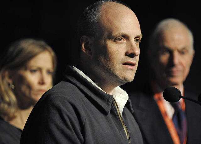 Howard Wolfson, deputy mayor of New York, speaks during a news conference as Mary Wittenberg, president of the New York Road Runners, and George Hirsch, chairman of the board of the Road Runners, listen on Friday, Nov. 2, 2012, in New York, after New York Mayor Michael Bloomberg canceled the New York City Marathon, in the aftermath of Superstorm Sandy. (AP Photo/ Louis Lanzano)