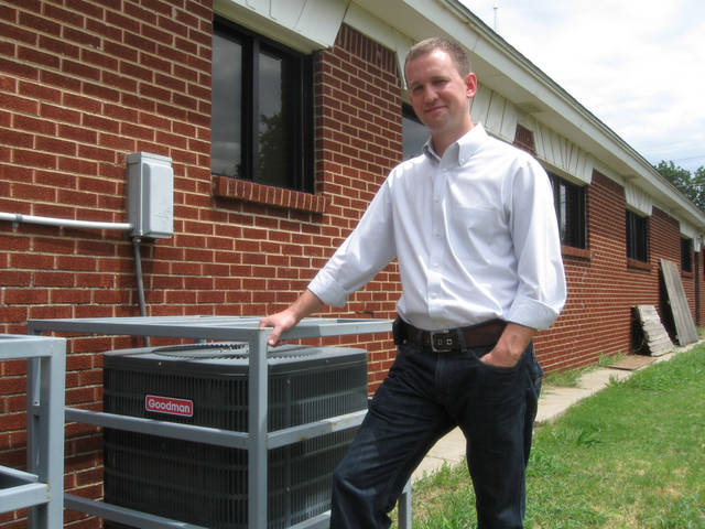 The Rev. Darrell Stetler II, senior pastor of Bible Methodist Church, stands besides a new air-conditioning unit recently installed at the church, 5801 S Douglas. Photo by Carla Hinton, The Oklahoman