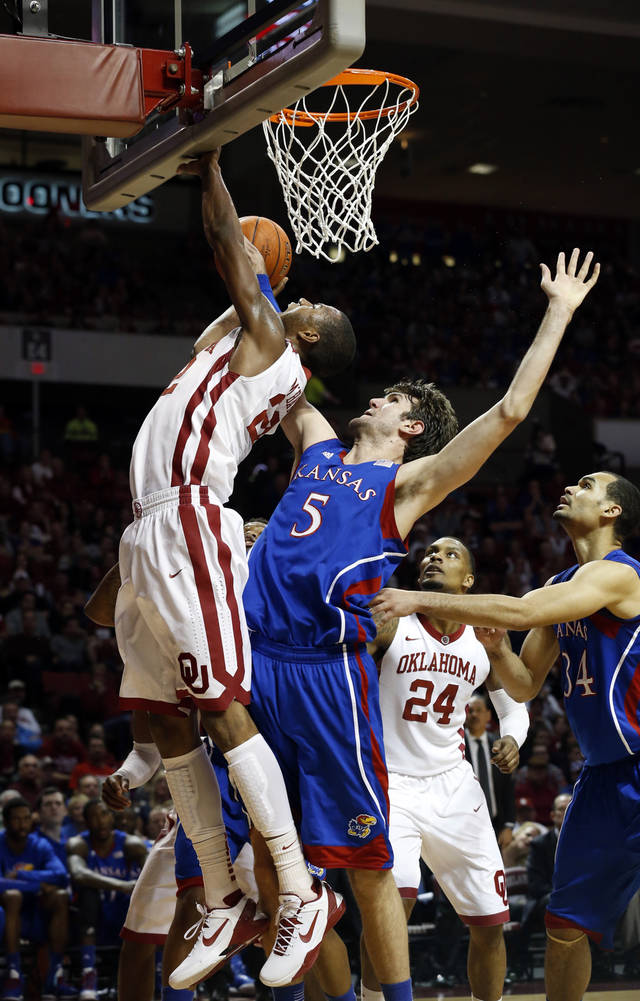 Oklahoma's Amath M'Baye (22) shoots defended by Kansas' Jeff Withey (5) as the University of Oklahoma Sooners (OU) play the Kansas Jayhawks (KU) in NCAA, men's college basketball at The Lloyd Noble Center on Saturday, Feb. 9, 2013 in Norman, Okla. Photo by Steve Sisney, The Oklahoman