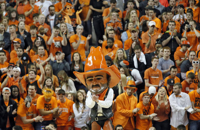 Cowboy fan show their support during the college basketball game between the Oklahoma State University Cowboys (OSU) and the University of Kanas Jayhawks (KU) at Gallagher-Iba Arena on Wednesday, Feb. 20, 2013, in Stillwater, Okla. Photo by Chris Landsberger, The Oklahoman