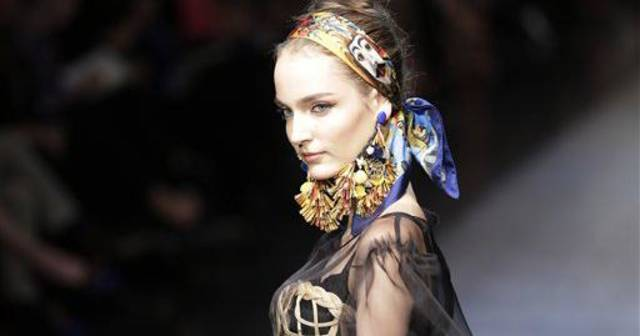 A model wears a creation part of the Dolce &amp; Gabbana women&#039;s Fall-Winter 2012-13 fashion collection, during the fashion week in Milan, Italy, Sunday, Feb. 26, 2012. (AP Photo/Antonio Calanni)