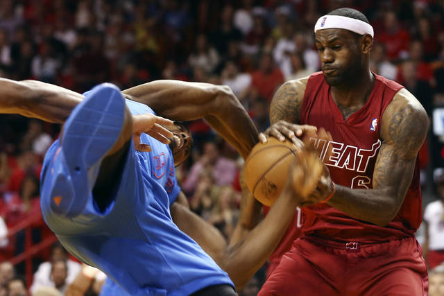 Oklahoma City Thunder's Serge Ibaka (9) and Miami Heat's LeBron James (6) battle for the ball during the second half of an NBA basketball game in Miami, Tuesday, Dec. 25, 2012. The Heat won 103-97. (AP Photo/J Pat Carter) ORG XMIT: FLJC110